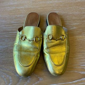 Gucci gold loafers